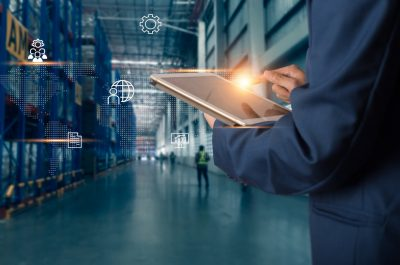 Business Logistics concept, Businessman manager using tablet check and control for workers with Modern Trade warehouse logistics. Industry 4.0 concept